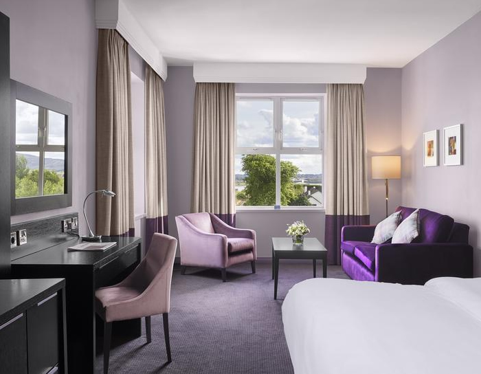 Purple coloured bedroom within Radisson Hotel Sligo